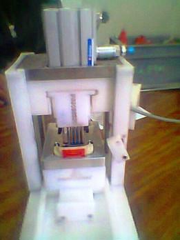 machine d'insertion des bouchons