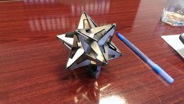 Gravitation (M. C. Escher) sheetmetal small stellated dodecahedron