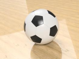 Football on wooden floor