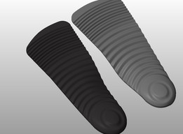 Shoe inserts with controlled concentric bending pattern