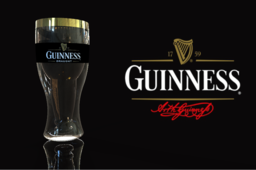 Guinness beer glass with bottle shaped inside.