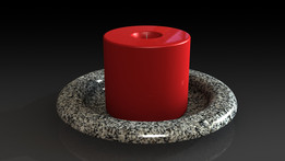 Red candle on a granite plate